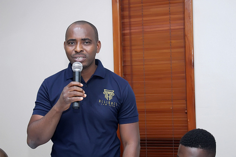 Mike Ajaegbo, a Senior Associate; during the introduction of team members