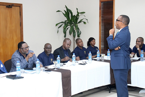 The guest speaker, Mr. Chidi Okoro facing the Partners of the Firm during the delivery of his lecture