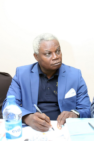Isaac Uche Obi, a partner in the Firm listening to the lecture