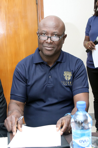 Theophilus Ochonogor, a Partner in the Firm during a photo session