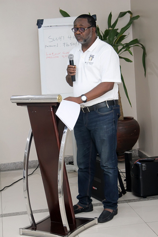 "The Managing Partner making his presentation titled, ""The Scale Game"""
