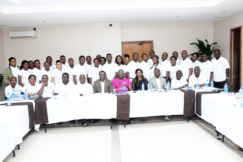 The entire members of staff in a photo session with the invited guest speaker of the second day